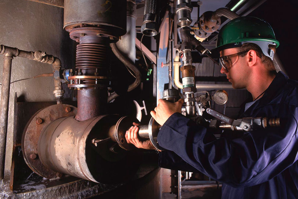 Operator adjusting an Air Products Air Products Cupola Oxy-fuel System  or APCOS burner